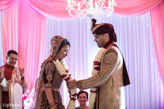 indian wedding ceremony,floral and decor,indian bride and groom,jaimala
