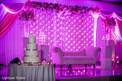 indian wedding reception,indian wedding decor,candle backdrop,indian wedding cake
