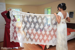 indian bride,sari draping,getting ready,white sari