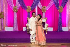 Adorable indian bride and groom at sangeet night
