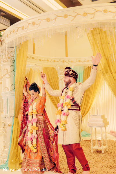 Happy Indian newly wedded couple.