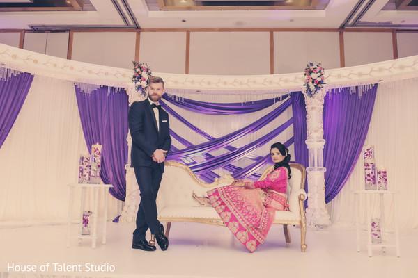 Indian couple posing during the wedding celebration.