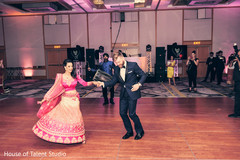 indian wedding reception decor,dhol player,indian bride and groom