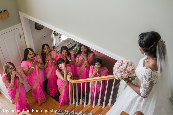 Dazzling indian bride walking down the stairs