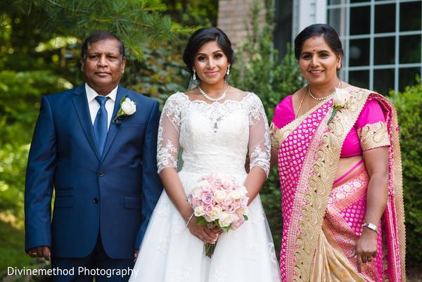 Sweet indian bride with parents portrait