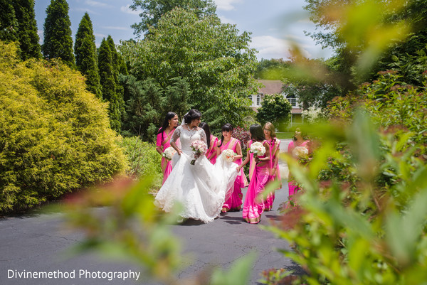 Indian bride walking with bridesmaids