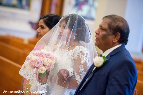 Indian bride making her entrance to christian wedding ceremony