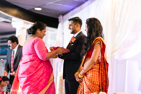 Indian Bride And Groom Receiving Wedding Gifts Photo 132794