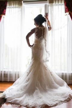 Indian bride magnificent white wedding dress.