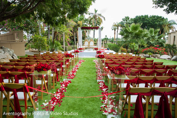 Red themed Indian wedding ceremony decor.