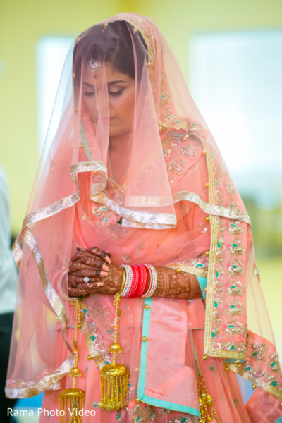 Sweet indian bride praying during the wedding ceremony