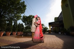 Lovely indian bride and groom in matching wedding outfits