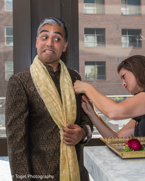 Indian groomsmen outfit final touch ups.