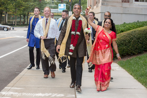 Indian groom with loving friends and family.