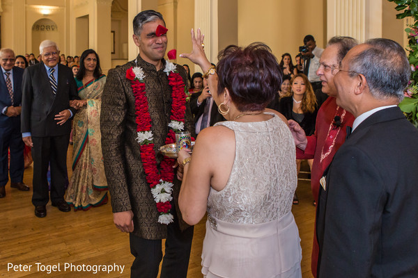 Traditional Indian groom welcome.