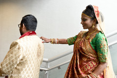 Indian bride and groom first look capture.