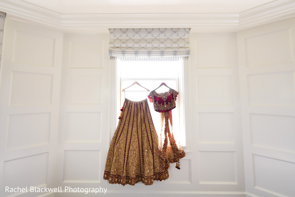 Red and gold bridal lengha in Half Moon Bay, CA Indian Fusion Wedding by Rachel Blackwell Photography