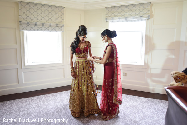 Stunning bride ready in her red and gold lengha