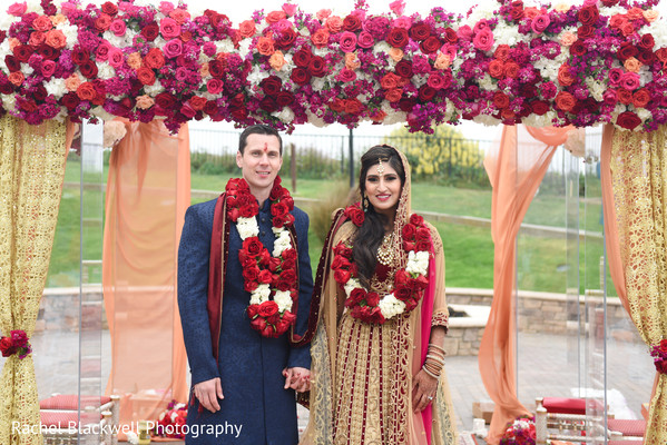 Stunning flower design mandap in Half Moon Bay, CA Indian Fusion Wedding by Rachel Blackwell Photography