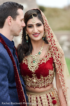 Gorgeous indian bride in red and gold lengha