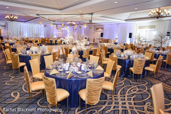 Gold and blue themed indian wedding reception decor