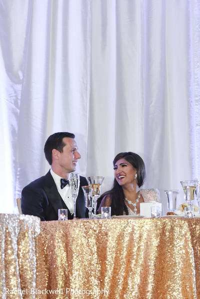 Indian couple at their wedding table