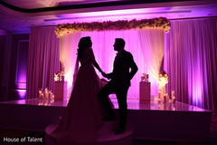 indian bride and groom,wedding stage,floral and decor,lightning