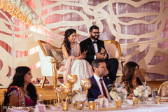 indian wedding reception,floral and decor,indian bride and groom