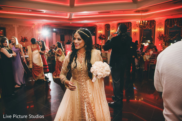 Gorgeous bride in golden lengha in Flushing, NY Fusion Indian Wedding by Live Picture Studios