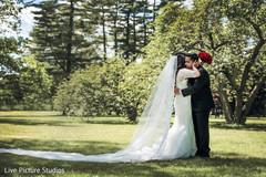 indian bride fashion,white wedding dress,red bridal bouquet