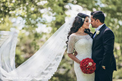 white wedding dress,indian bride fashion,red bridal bouquet
