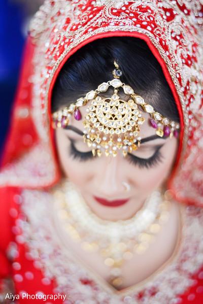 indian bride getting ready,indian bride fashion,bridal tikka