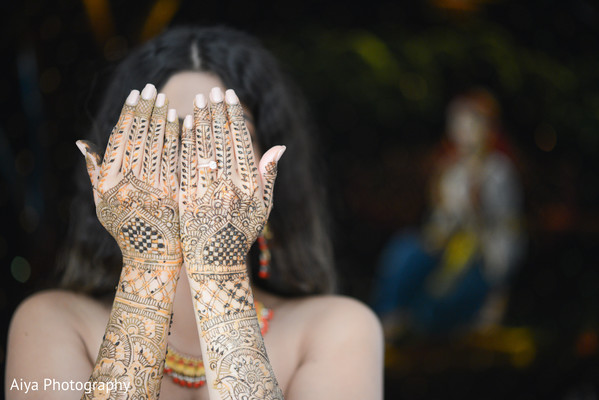 Indian bride showing mehndi art in Glenview, IL Indian Wedding by Aiya Photography