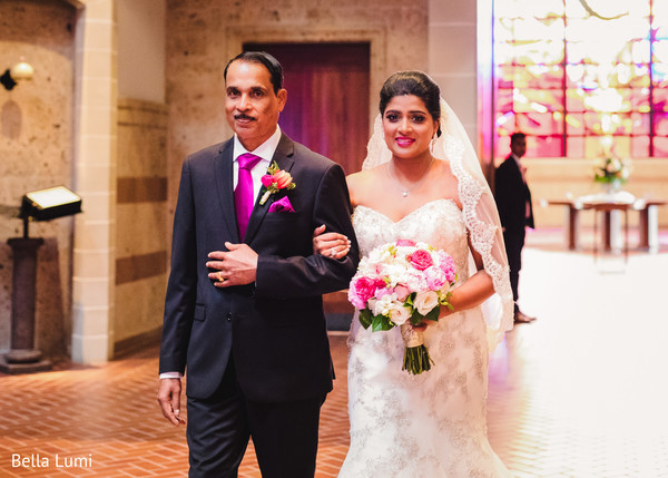 Stunning Indian bride walking in alongside her father in Texas City, TX South Asian Wedding by Bella Lumi
