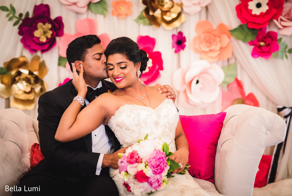 Indian couple posing during their wedding celebration in Texas City, TX South Asian Wedding by Bella Lumi