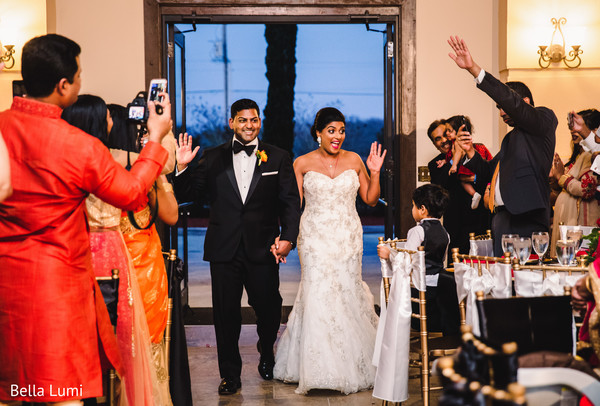 Indian couple making their grand entrance in Texas City, TX South Asian Wedding by Bella Lumi