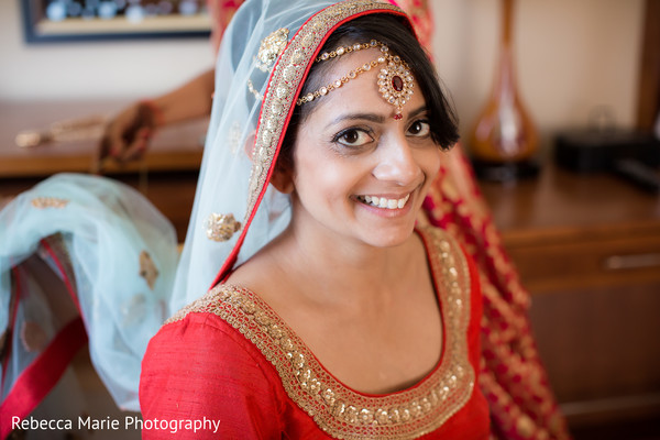 Charming indian bride getting ready
