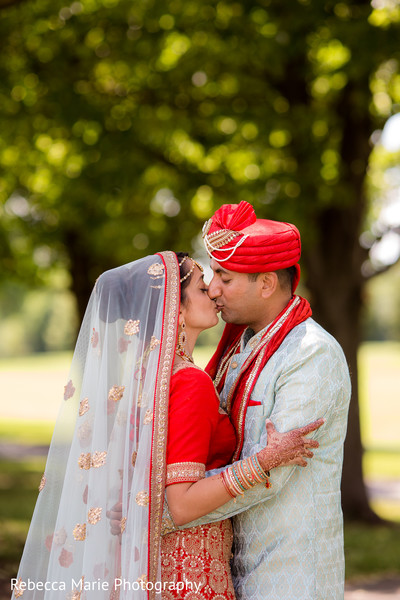 Sweet indian bride and groom kissing