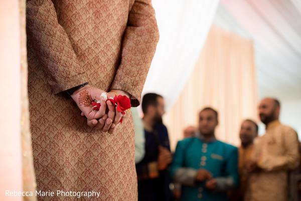 Indian groomsmen holding flower petals