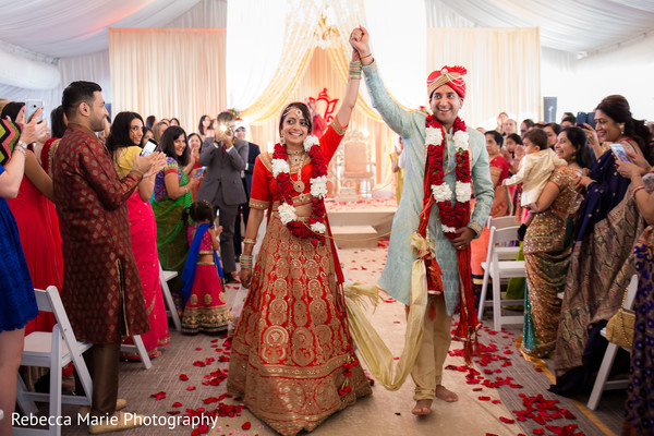 Indian newlyweds leaving wedding ceremony