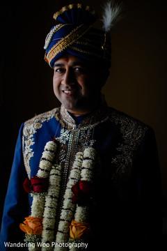Indian groom in blue sherwani