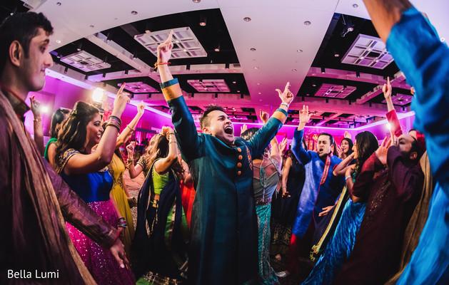 Indian groom enjoying sangeet party