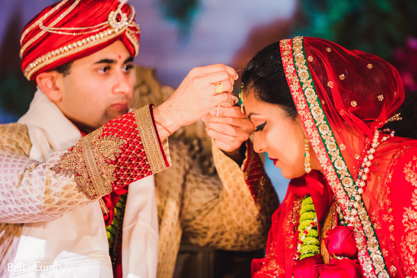 indian wedding ceremony,indian bride and groom,indian wedding ceremony photography,sindhoor wedding ritual
