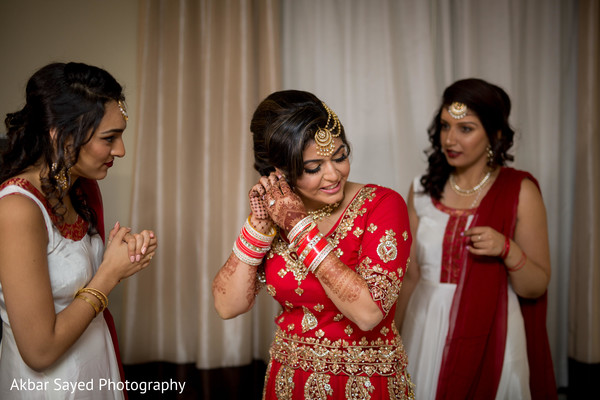 Sweet indian bride putting jewelry on