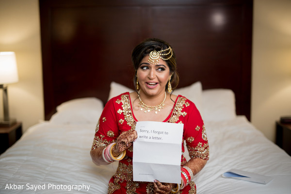 Indian bride receiving funny letter from groom