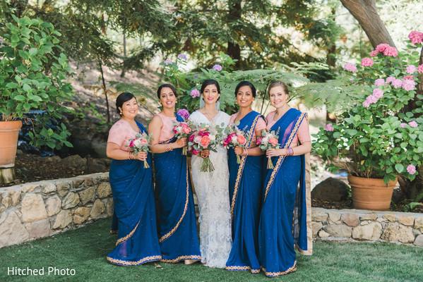 Beautiful blue and pink bridesmaids saris.