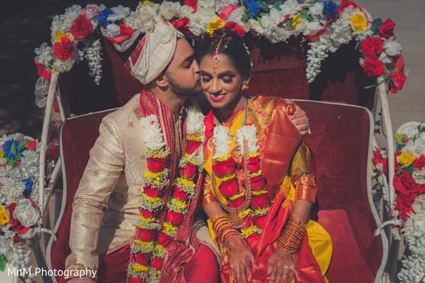 Cute indian couple leaving wedding ceremony venue
