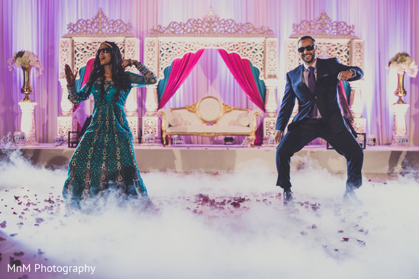 Cheerful indian couple's dance performance