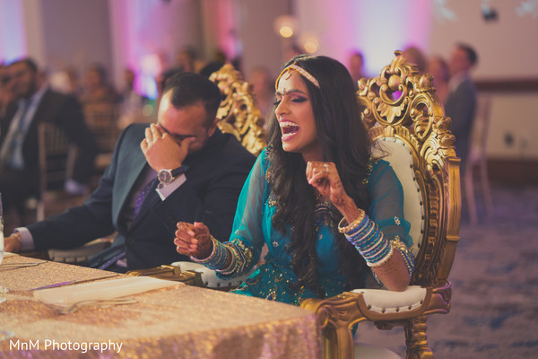 Indian bride and groom laughing during wedding reception