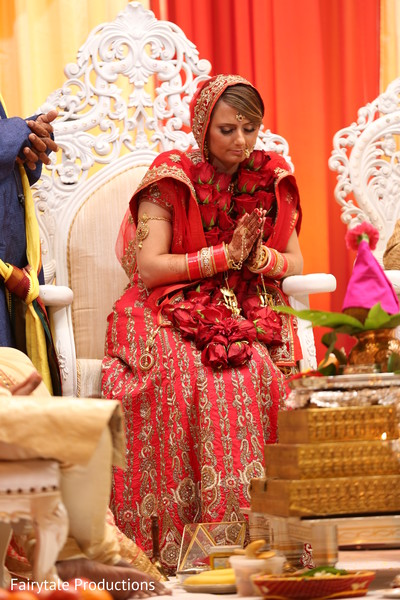 Beautiful Indian bride praying during the ceremony.
